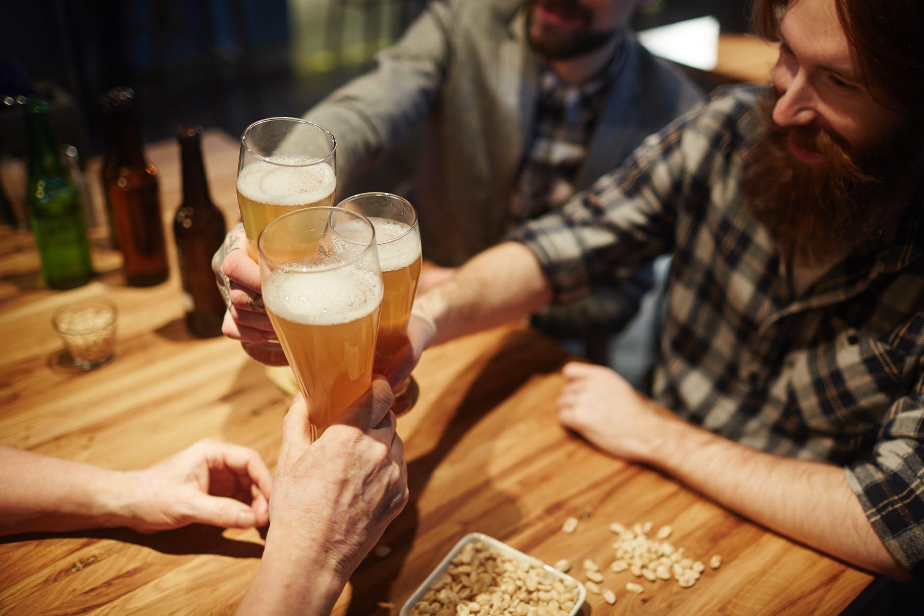 men toasting at a bar